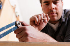 Carpenter with angle and pencil Royalty Free Stock Photo