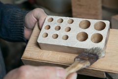 Carpenter applying glue  Stock Photography