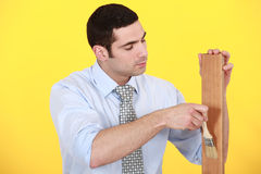 Carpenter applying varnish Royalty Free Stock Images