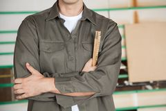 Carpenter With Arms Crossed Holding Ruler Stock Photos