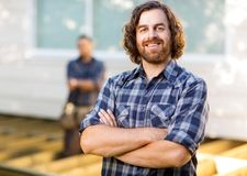 Carpenter With Arms Crossed Standing At Royalty Free Stock Image