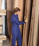 Carpenter Arranging Wooden Planks In Workshop Royalty Free Stock Photo
