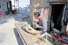 Carpenter artisan make boat model Royalty Free Stock Photography