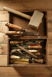 Carpenter artist wooden craftman toolbox. Over wood background Stock Photos