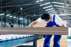 Carpenter in Asian wood workshop working on boards Royalty Free Stock Images