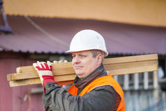 Carpenter with boards Stock Image