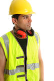 Carpenter builder looking at your message. Carpenter, builder, labourer or construction worker looking sideways.  Suitable for a message, White background Stock Photo