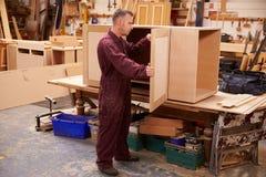 Carpenter Building Furniture In Workshop Royalty Free Stock Photos