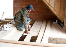 Carpenter building new floor stock photos