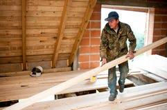 Carpenter building new floor stock image