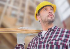 Carpenter on building site Royalty Free Stock Image