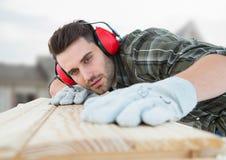 Carpenter on building site Stock Image