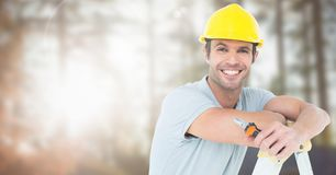 Carpenter on building site. Digital composite of Carpenter on building site Royalty Free Stock Photo
