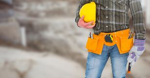 Carpenter on building site Stock Photo