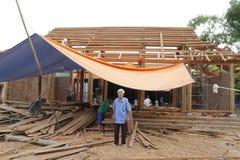 Carpenter building a temple Stock Photography