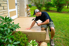 Carpenter Bulding Deck With Hammer Stock Photos