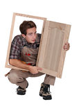 Carpenter with cabinet door Stock Photography