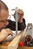 Сarpenter with calipers. Stock Photo