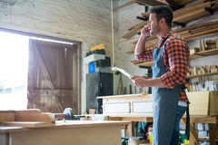 Carpenter calling someone Royalty Free Stock Images