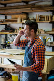 Carpenter calling someone Royalty Free Stock Photography