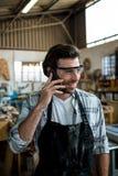 Carpenter calling someone Stock Images