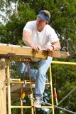 Carpenter Checking Straight Line royalty free stock photography