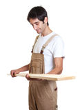 Carpenter checking wooden beam Royalty Free Stock Images