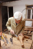 Carpenter with chiesel Royalty Free Stock Image