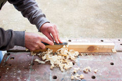 Carpenter chiselling wood. In vice Royalty Free Stock Photos