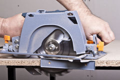 Carpenter with circular saw Royalty Free Stock Photo
