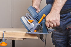 Carpenter with circular saw Royalty Free Stock Images
