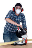 Carpenter with a circular saw. Stock Photography
