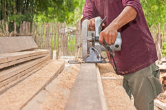 Carpenter. Circular Saw Cuts Stud for Home Remodeling Project Royalty Free Stock Photos