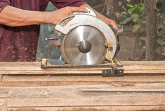 Carpenter. Circular Saw Cuts Stud for Home Remodeling Project Royalty Free Stock Images