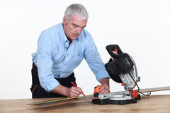 Carpenter with a circular saw. Stock Image
