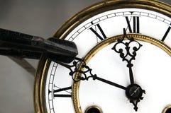 Carpenter clamp stop the clock. Royalty Free Stock Photos