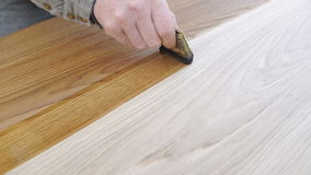 Carpenter is covering table by lacquer stock video footage