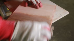 Carpenter covers the mordant plaque, dry wood stock footage