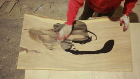 Carpenter covers the mordant plaque, dry wood, accelerated shooting. Carpenter covers the mordant plaque, dry wood stock video