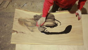 Carpenter covers the mordant plaque, dry wood stock video