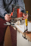 Carpenter crafting furniture detail Stock Images
