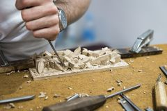 Carpenter craftsman carving Wood  with tools. Carpenter craftsman carving Wood with tools in a workshop Stock Images