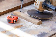 Carpenter cut wood for house construction Royalty Free Stock Image