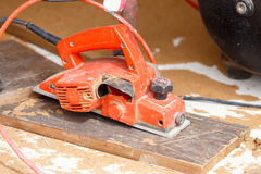 Carpenter cut wood for house construction Stock Photos