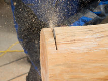 Carpenter is cutting a log Stock Images