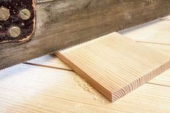 Carpenter cutting plank Royalty Free Stock Photography