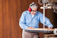 Carpenter Cutting Wood With Bandsaw Stock Images