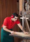 Carpenter Cutting Wood With Bandsaw Stock Photo