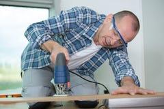 Carpenter cutting wood board. Man Royalty Free Stock Images