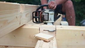 Carpenter cutting wood with circular saw. The carpenter sawing the wood. Wood dust in the air. Woodwork concept stock video